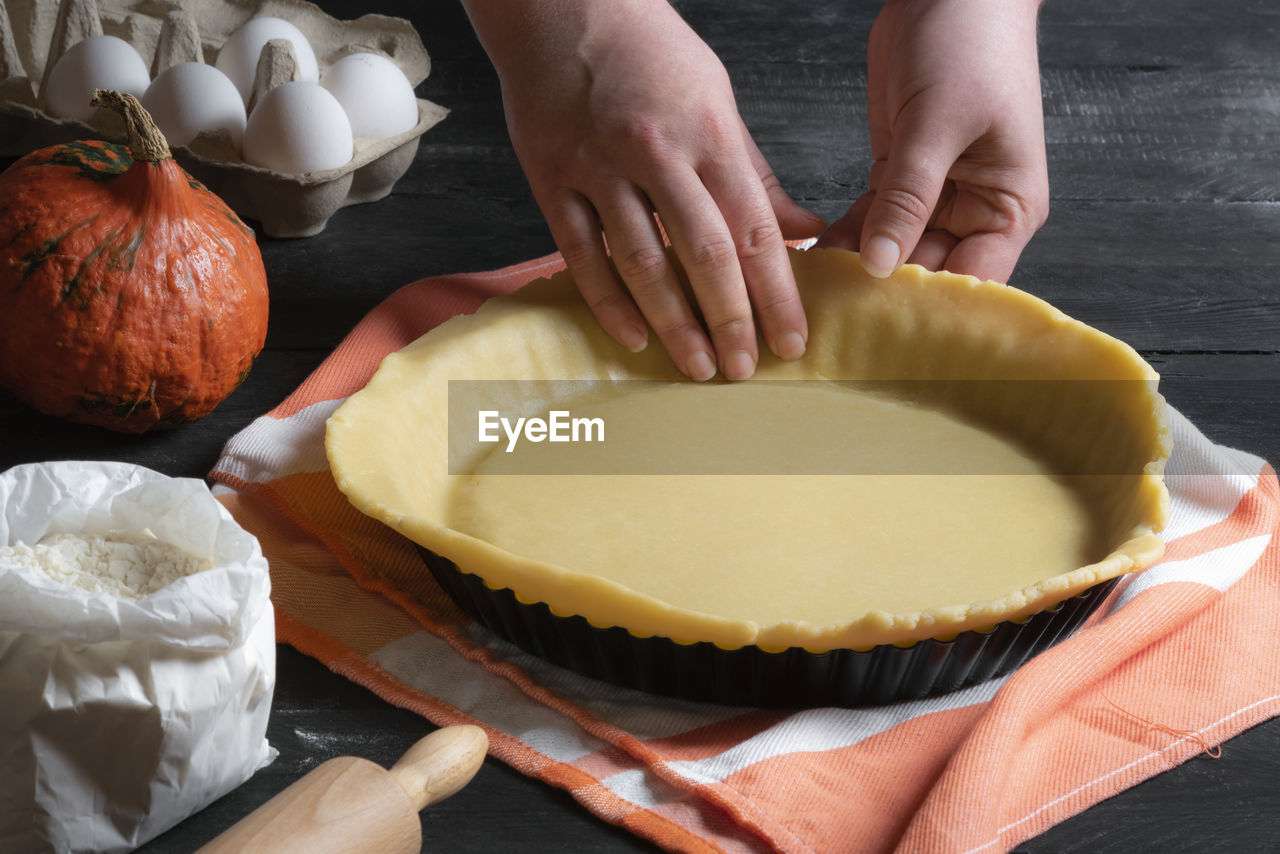 Cropped Hands Making Pie