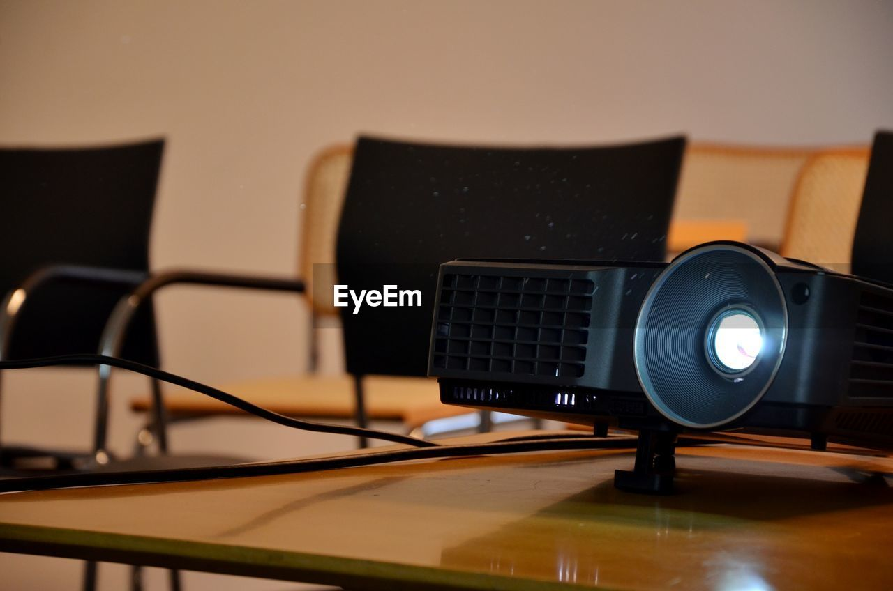 Close-Up Of Projection Equipment On Table