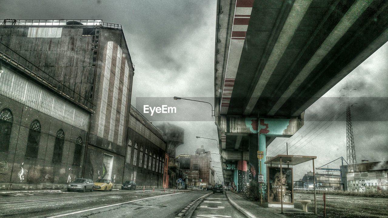 architecture, transportation, built structure, road, street, city, building exterior, bridge - man made structure, outdoors, sky, day, cloud - sky, no people