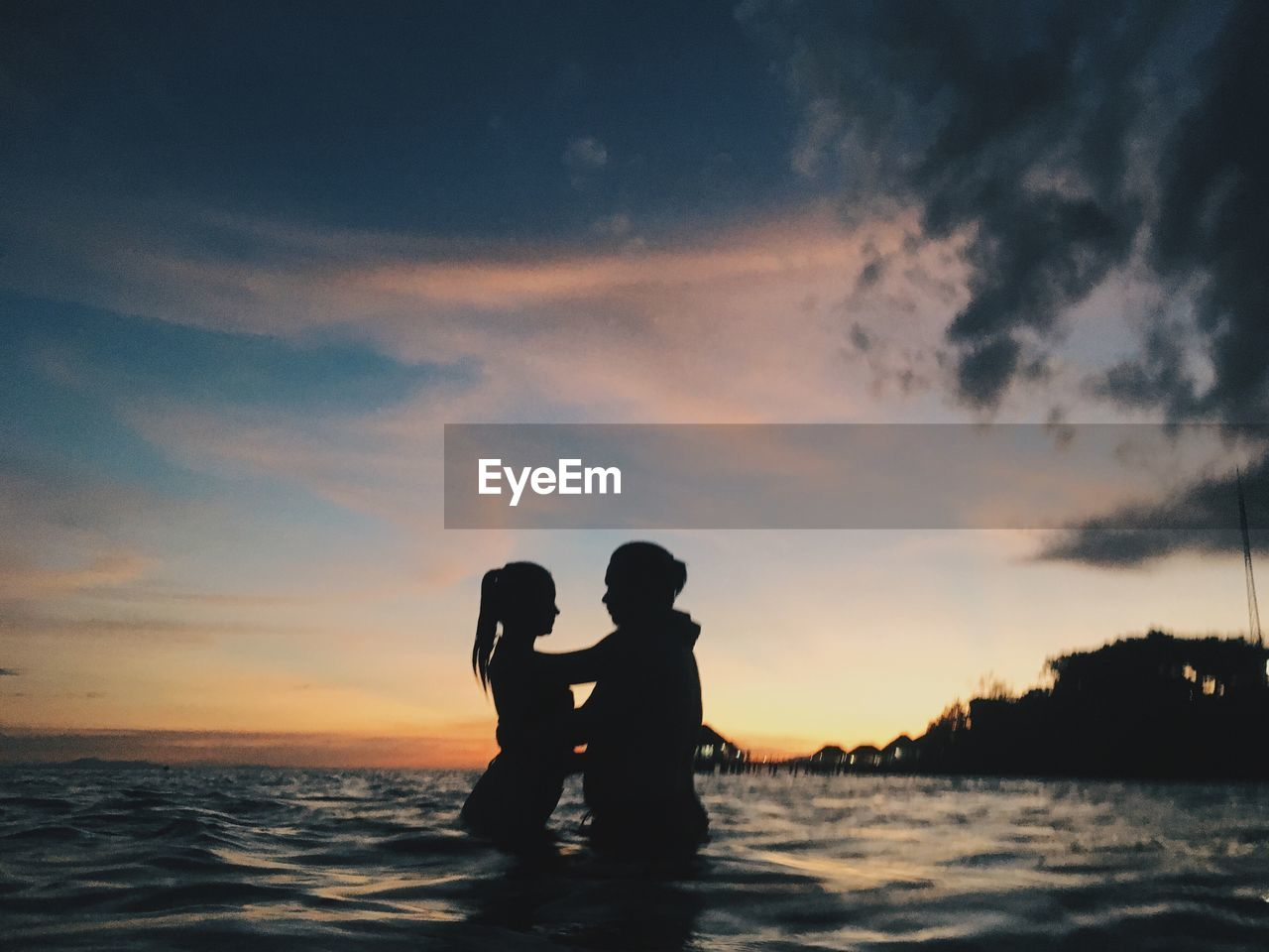 sky, two people, cloud - sky, sunset, togetherness, water, sea, silhouette, love, men, positive emotion, bonding, women, adult, nature, leisure activity, real people, beauty in nature, standing, horizon over water, outdoors, couple - relationship