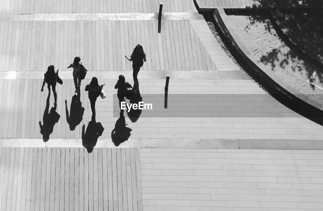 High Angle View Of Women Walking On Footpath