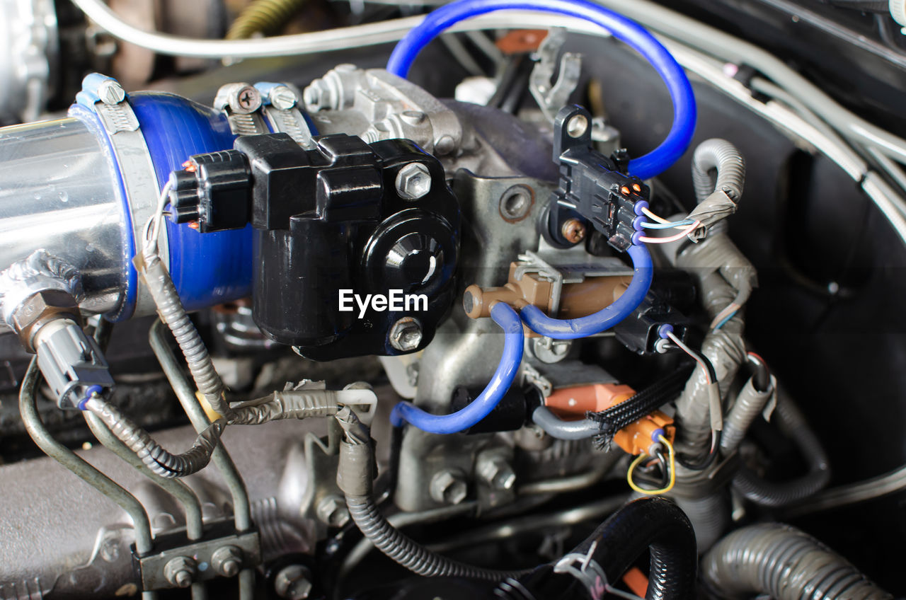 engine, mode of transportation, transportation, technology, close-up, motor vehicle, car, land vehicle, metal, vehicle part, machinery, no people, day, machine part, indoors, equipment, stationary, automobile industry, motorcycle, complexity, silver colored, clean, mechanic, chrome