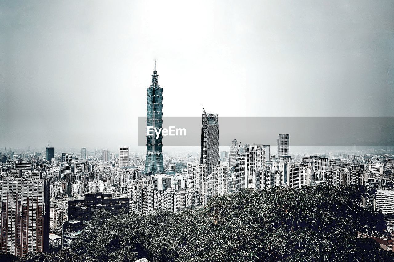 skyscraper, architecture, building exterior, city, cityscape, modern, built structure, high angle view, travel destinations, urban skyline, no people, downtown district, day, outdoors, growth, tree, sky