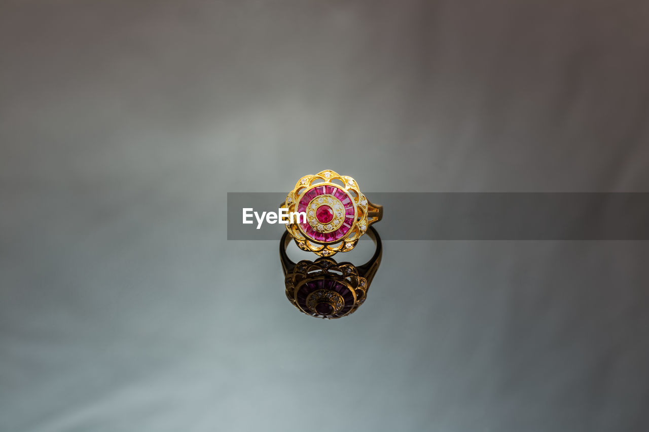 close-up, no people, copy space, jewelry, still life, indoors, single object, focus on foreground, animal themes, animal, art and craft, day, selective focus, animal wildlife, pattern, earring, ring, craft, nature, personal accessory