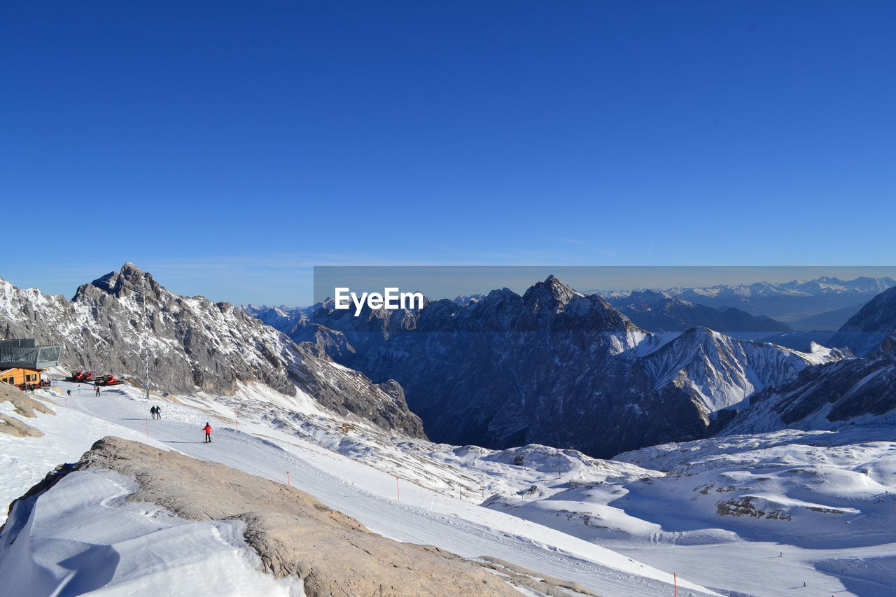 mountain, sky, scenics - nature, beauty in nature, winter, snow, cold temperature, copy space, environment, non-urban scene, blue, landscape, mountain range, nature, day, tranquil scene, clear sky, tranquility, snowcapped mountain