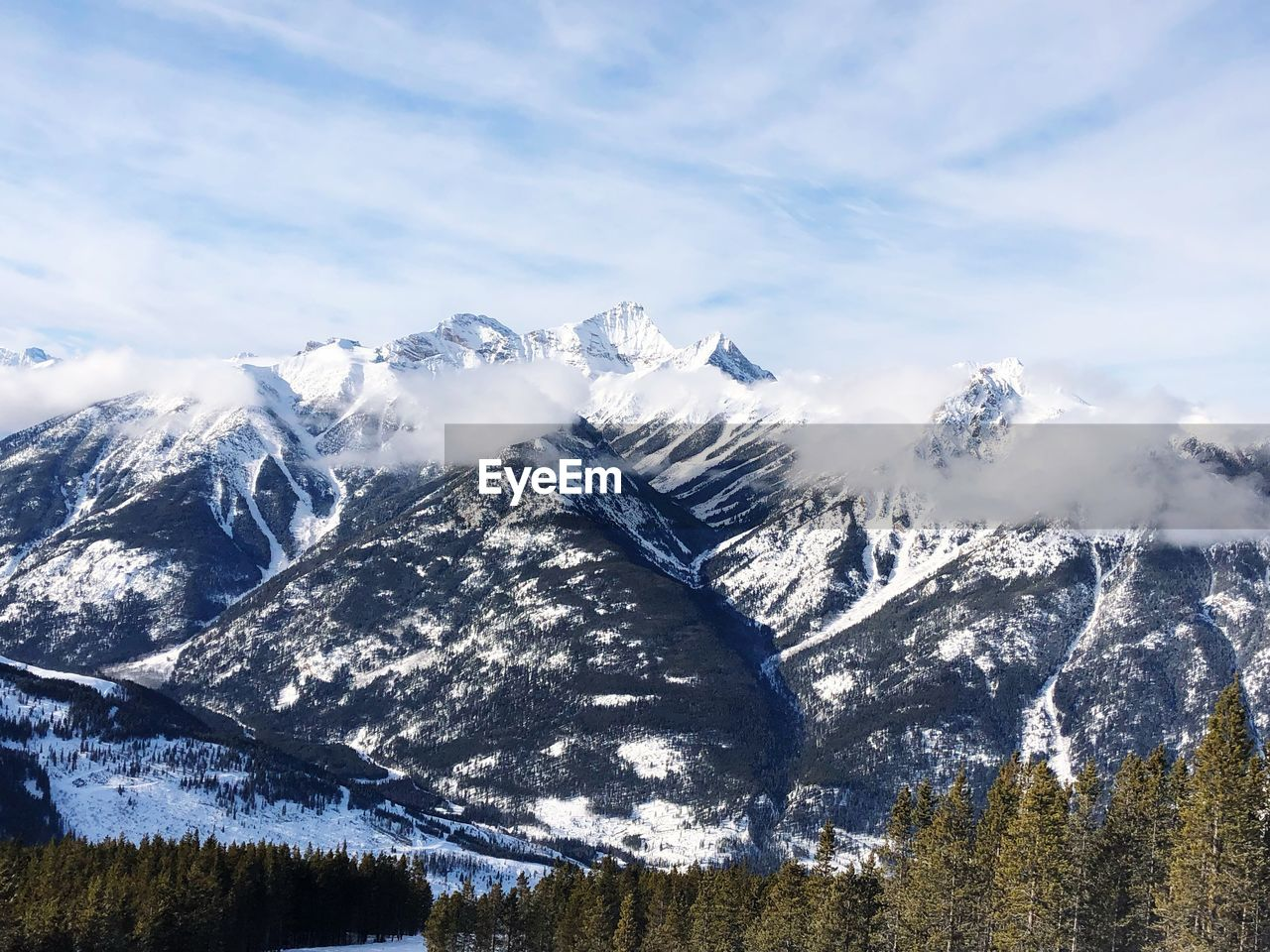 mountain, scenics - nature, winter, beauty in nature, cold temperature, sky, snow, tranquility, tranquil scene, environment, cloud - sky, snowcapped mountain, plant, non-urban scene, mountain range, landscape, tree, no people, nature, mountain peak, range
