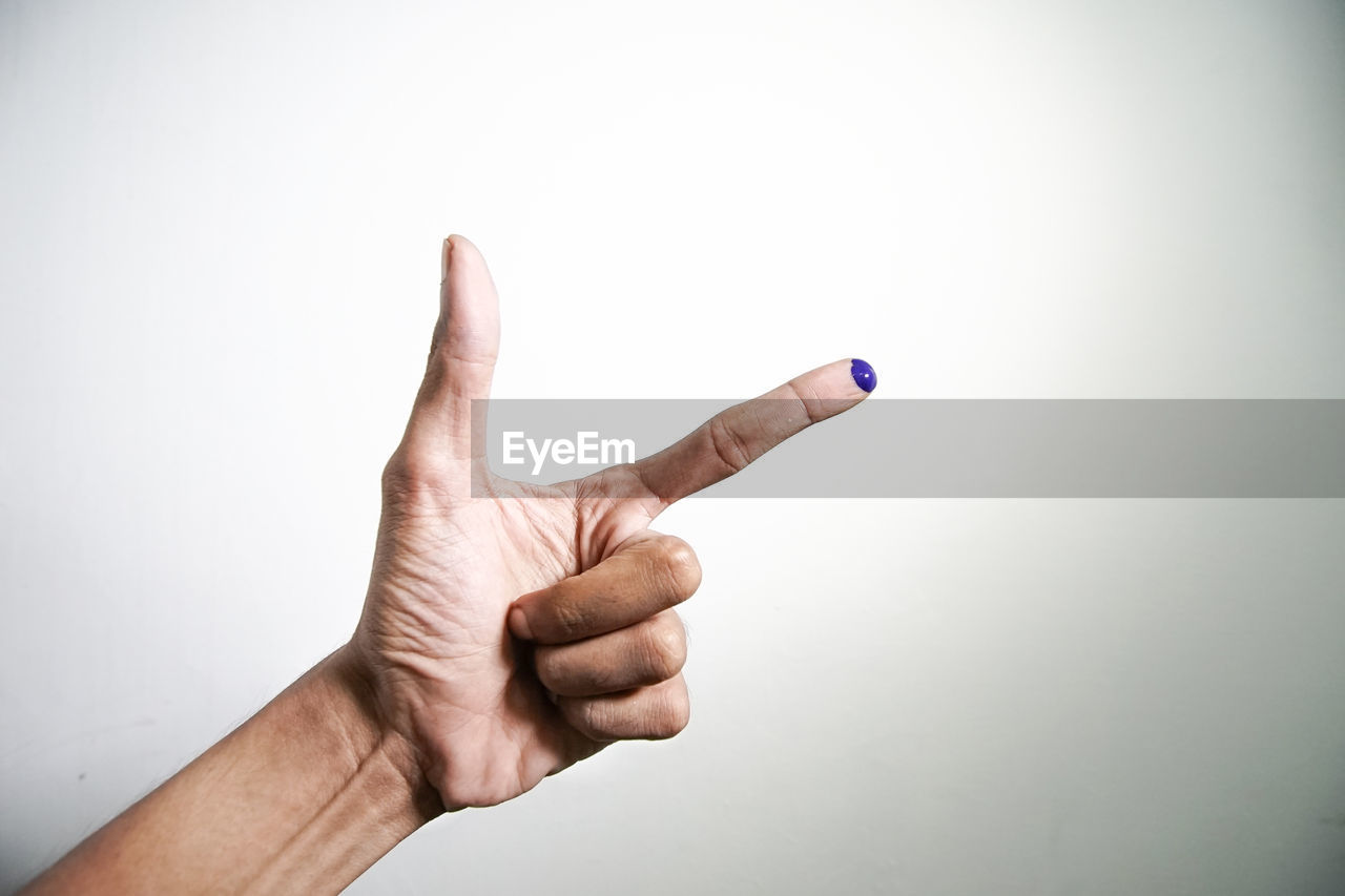 human hand, hand, human body part, one person, studio shot, finger, human finger, gesturing, indoors, white background, body part, showing, copy space, unrecognizable person, success, hand sign, close-up, pointing, men, human limb, aggression, good news