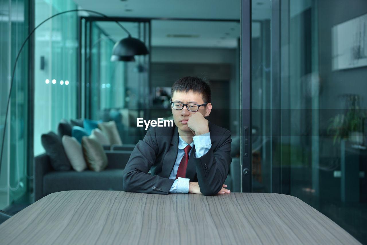 Sad Businessman Sitting At Office