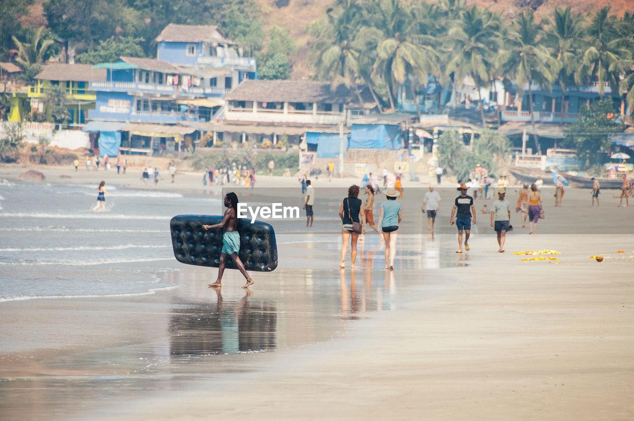 MEN AT BEACH