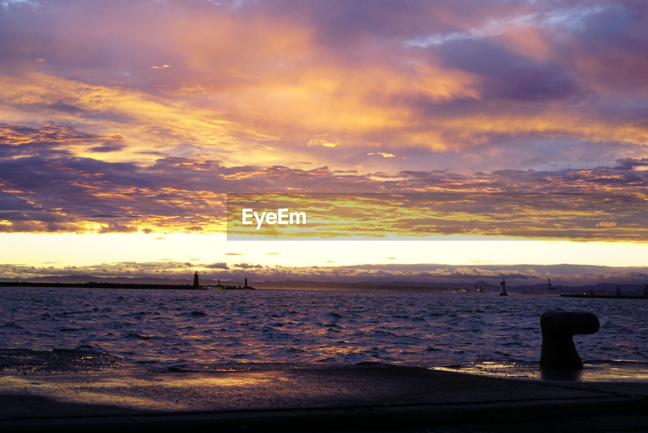 sunset, sea, water, cloud - sky, sky, beauty in nature, nature, scenics, orange color, horizon over water, silhouette, tranquil scene, outdoors, tranquility, no people, beach, day