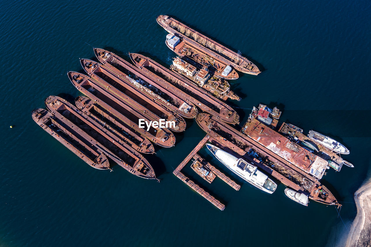 HIGH ANGLE VIEW OF SHIP MOORED IN HARBOR