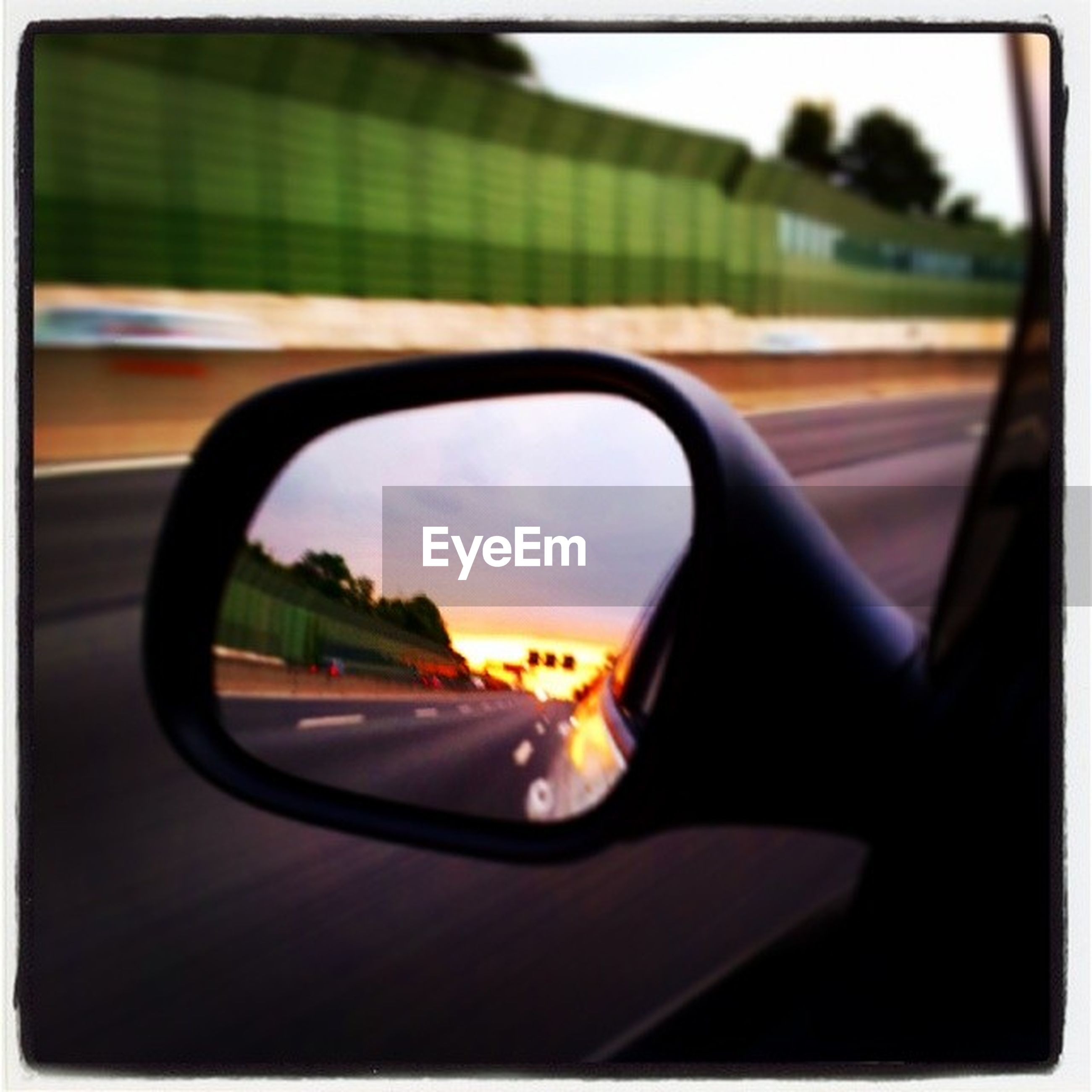 transportation, land vehicle, car, mode of transport, side-view mirror, reflection, sunset, car interior, transfer print, glass - material, part of, transparent, one person, vehicle interior, auto post production filter, close-up, road, travel, sky, cropped