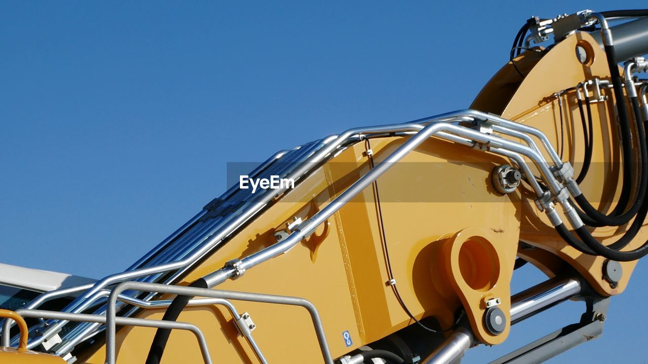 Close-Up Of Crane Against Sky