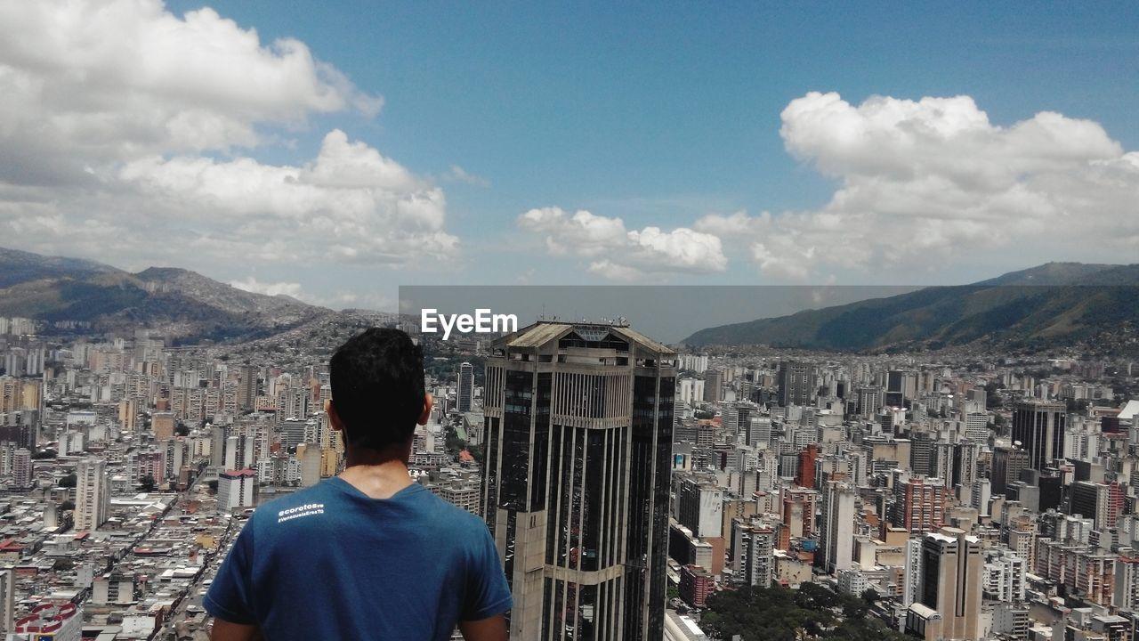 Man Overlooking Cityscape