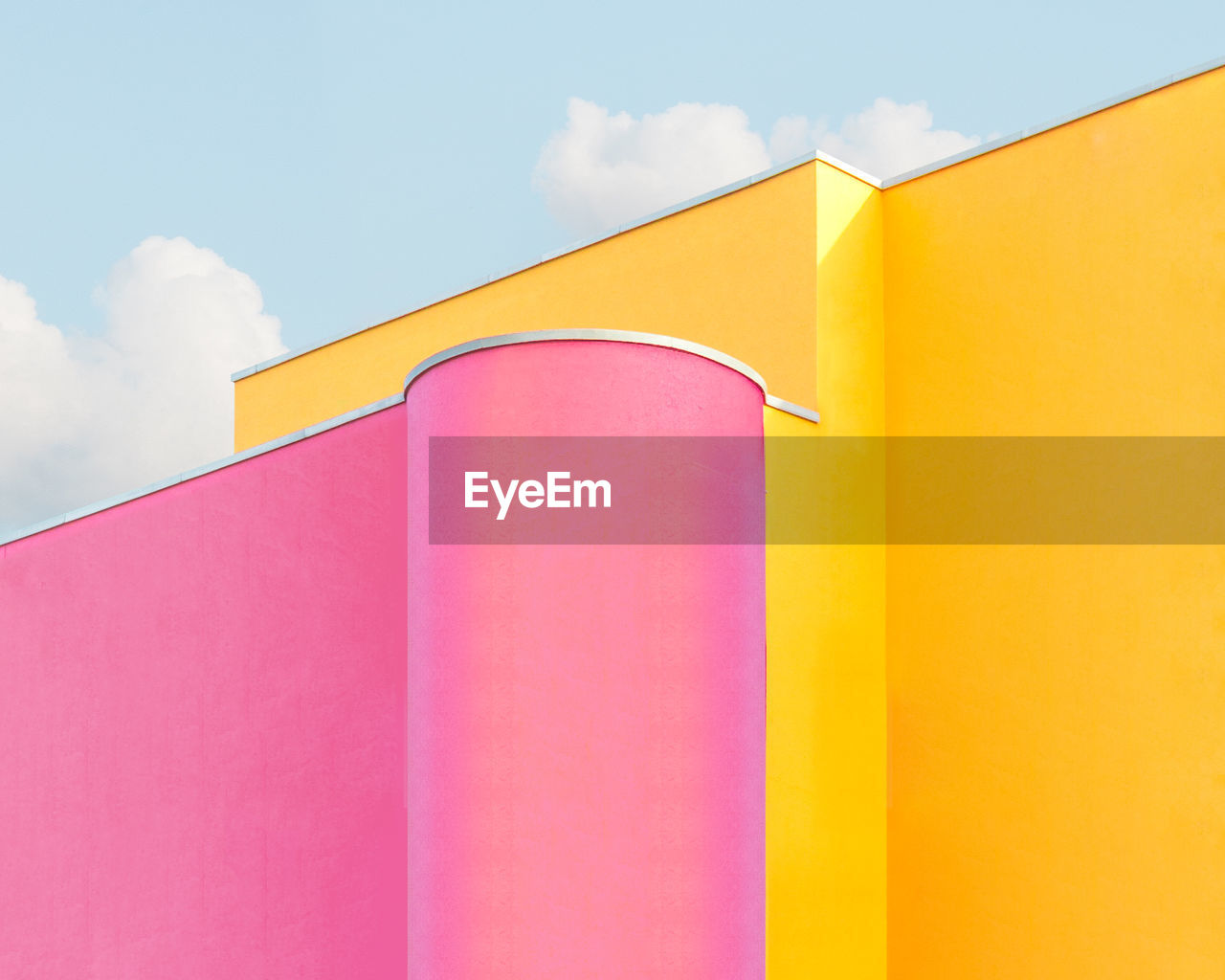 built structure, architecture, yellow, sky, cloud - sky, no people, building exterior, multi colored, day, low angle view, building, pink color, wall - building feature, outdoors, red, orange color, nature, pattern, vibrant color, close-up