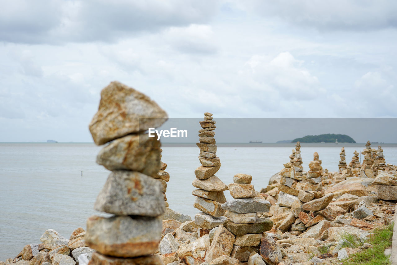 sea, cloud - sky, water, stack, sky, rock, scenics - nature, balance, tranquility, solid, beauty in nature, rock - object, tranquil scene, nature, land, day, no people, beach, non-urban scene, outdoors, horizon over water