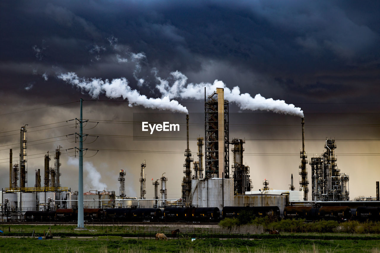 industry, sky, building exterior, environmental issues, factory, cloud - sky, smoke - physical structure, smoke stack, pollution, built structure, fuel and power generation, architecture, nature, environment, air pollution, emitting, outdoors, no people, day, chimney, ecosystem, industrial district, power supply
