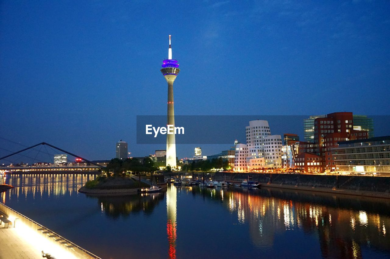 architecture, built structure, building exterior, sky, water, illuminated, reflection, waterfront, city, night, building, nature, tall - high, river, no people, tower, dusk, travel destinations, bridge, bridge - man made structure, office building exterior, outdoors, skyscraper, spire