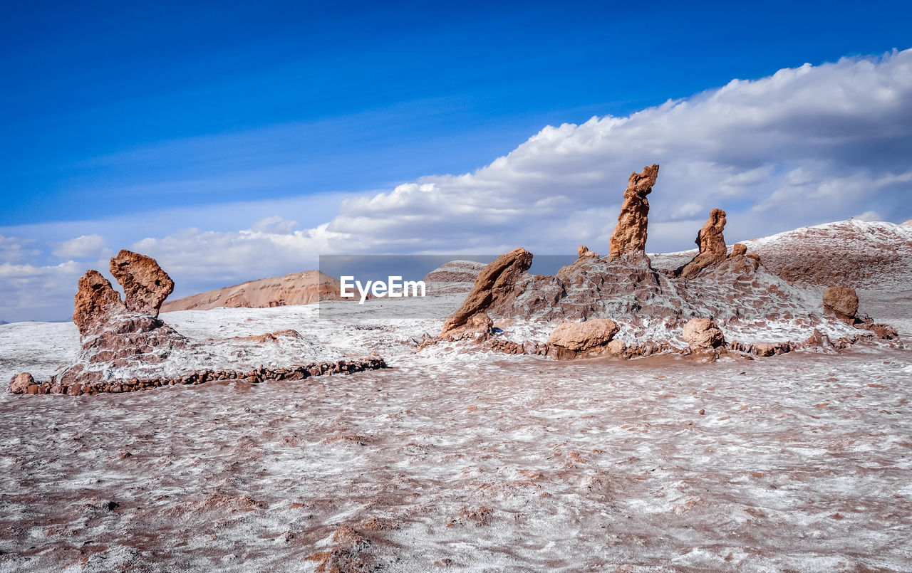 cloud - sky, sky, no people, nature, land, mammal, day, tranquility, rock, scenics - nature, environment, animal, blue, tranquil scene, beauty in nature, solid, animal themes, rock - object, non-urban scene, vertebrate, arid climate