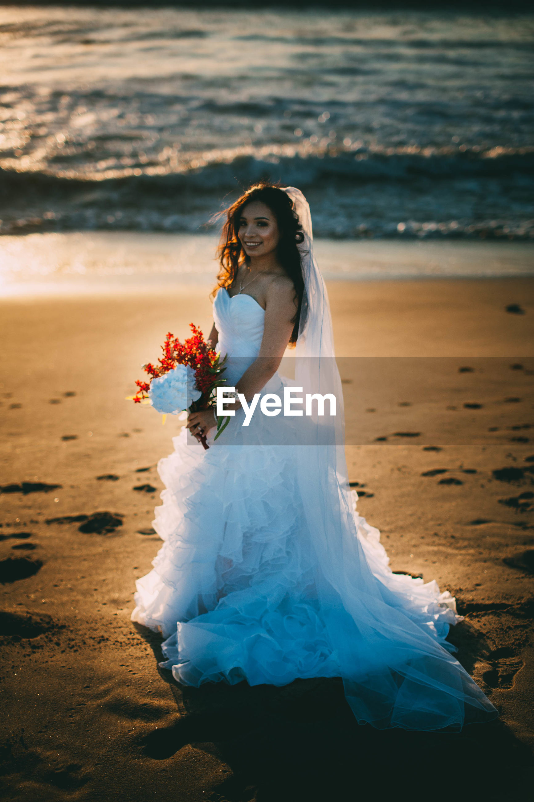 beach, real people, sea, shore, sand, wedding, bride, celebration, wedding dress, one person, life events, full length, women, lifestyles, young adult, front view, young women, water, outdoors, leisure activity, nature, standing, beauty in nature, day, beautiful woman, groom