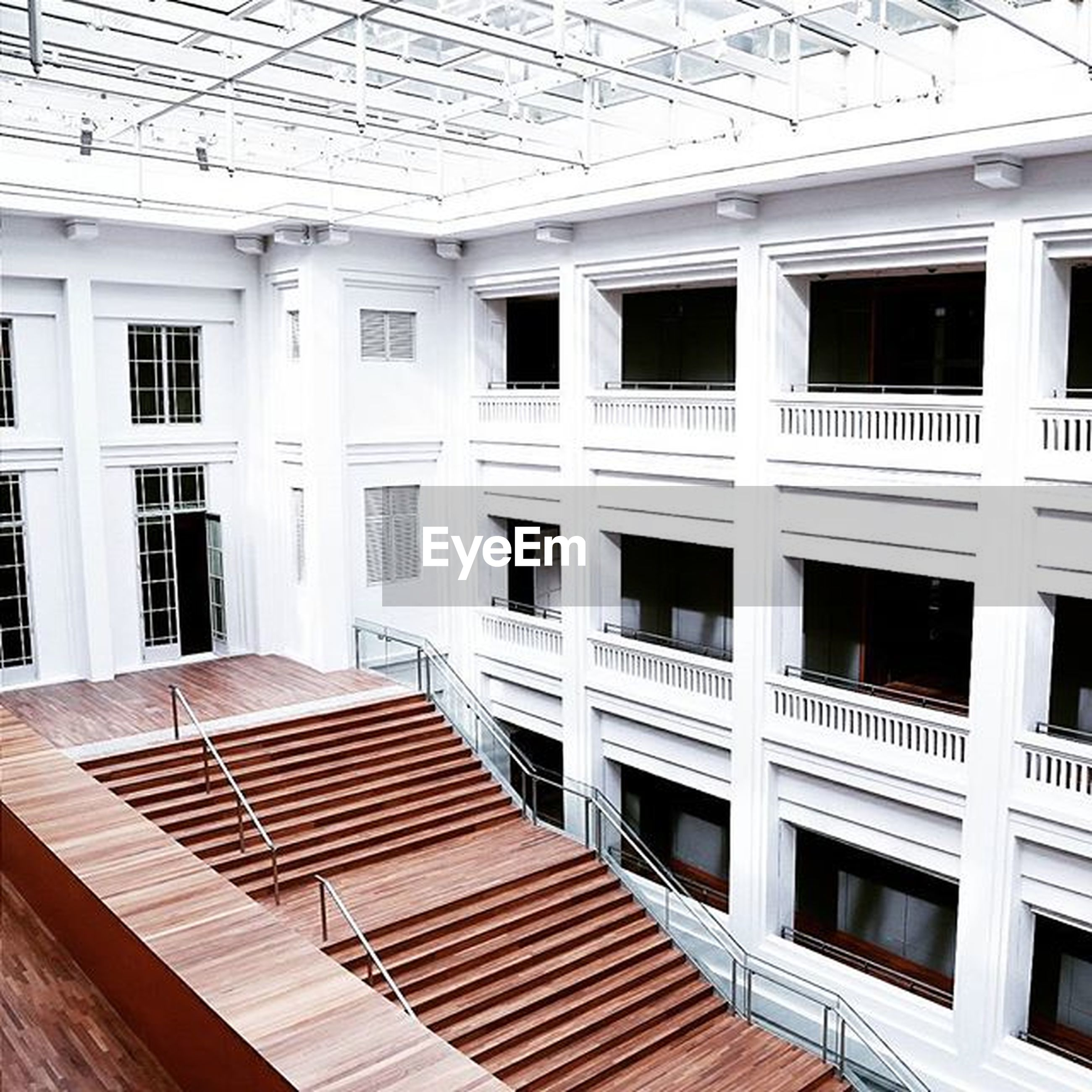 architecture, window, built structure, building exterior, indoors, building, glass - material, balcony, day, in a row, house, no people, door, empty, wood - material, absence, repetition, flooring, side by side, sunlight