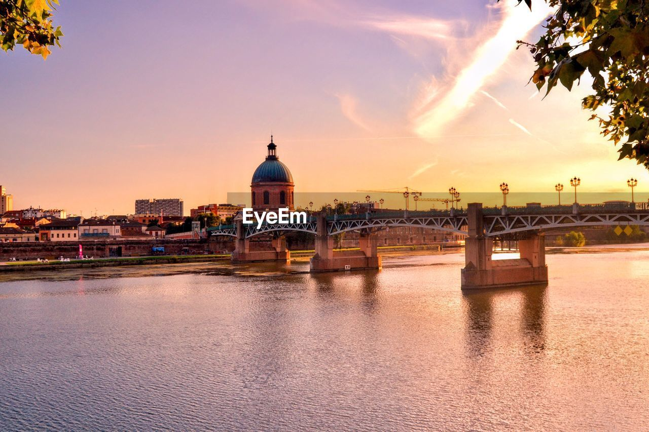 sky, architecture, built structure, building exterior, water, sunset, dome, nature, religion, place of worship, city, waterfront, cloud - sky, spirituality, building, connection, river, belief, bridge, no people, bridge - man made structure, outdoors, cityscape