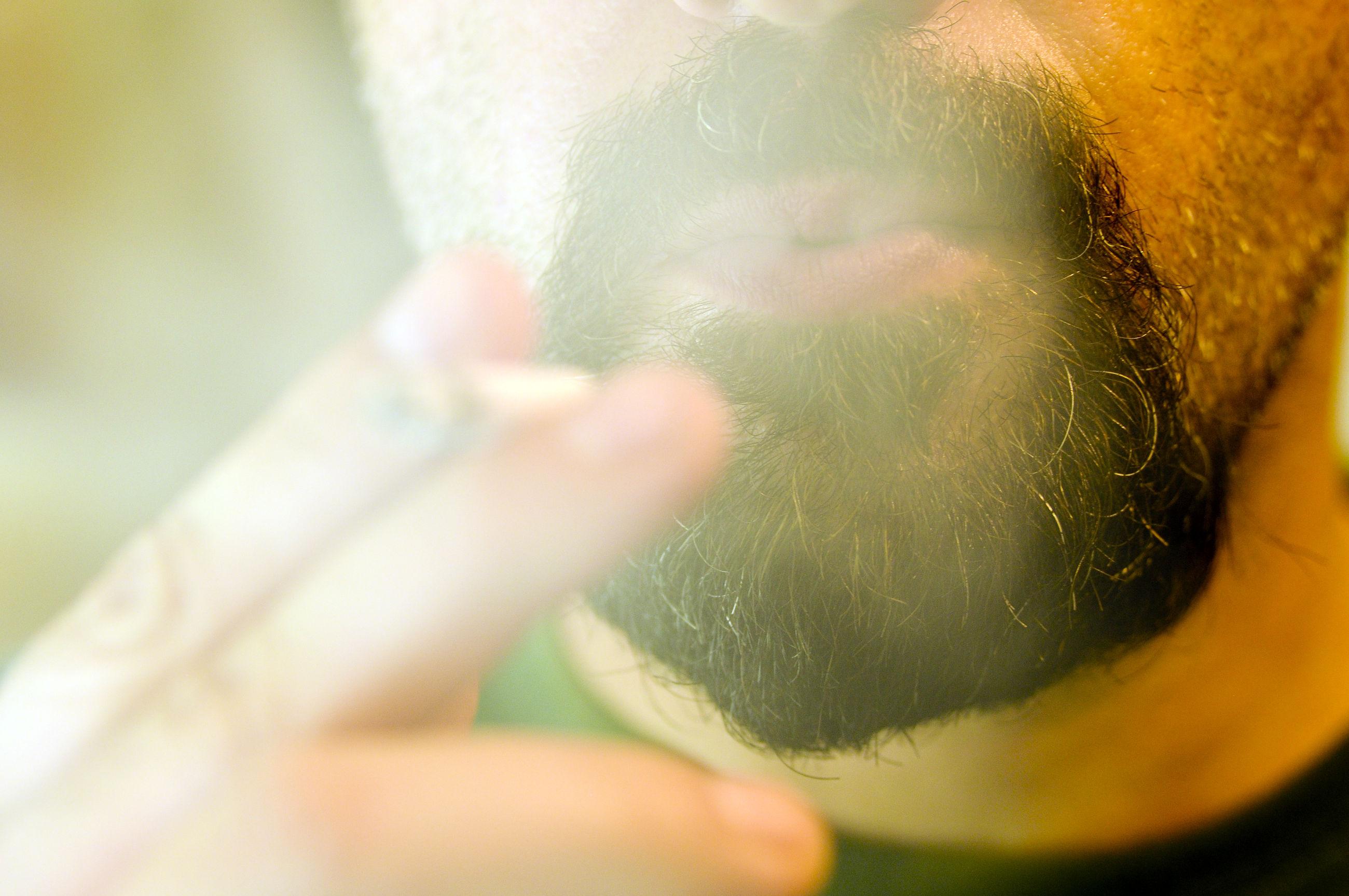 Close-up of man smoking cigarette