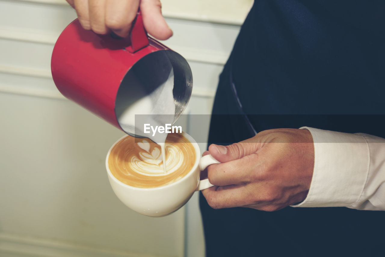 real people, coffee, cup, hand, coffee - drink, human hand, food and drink, holding, coffee cup, mug, drink, indoors, occupation, one person, human body part, refreshment, frothy drink, men, working, latte, barista, preparing food