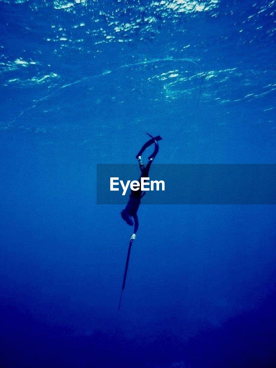 underwater, sea, water, undersea, swimming, blue, aquatic sport, scuba diving, diving equipment, real people, exploration, sport, diving flipper, adventure, nature, one person, leisure activity, unrecognizable person, underwater diving, marine