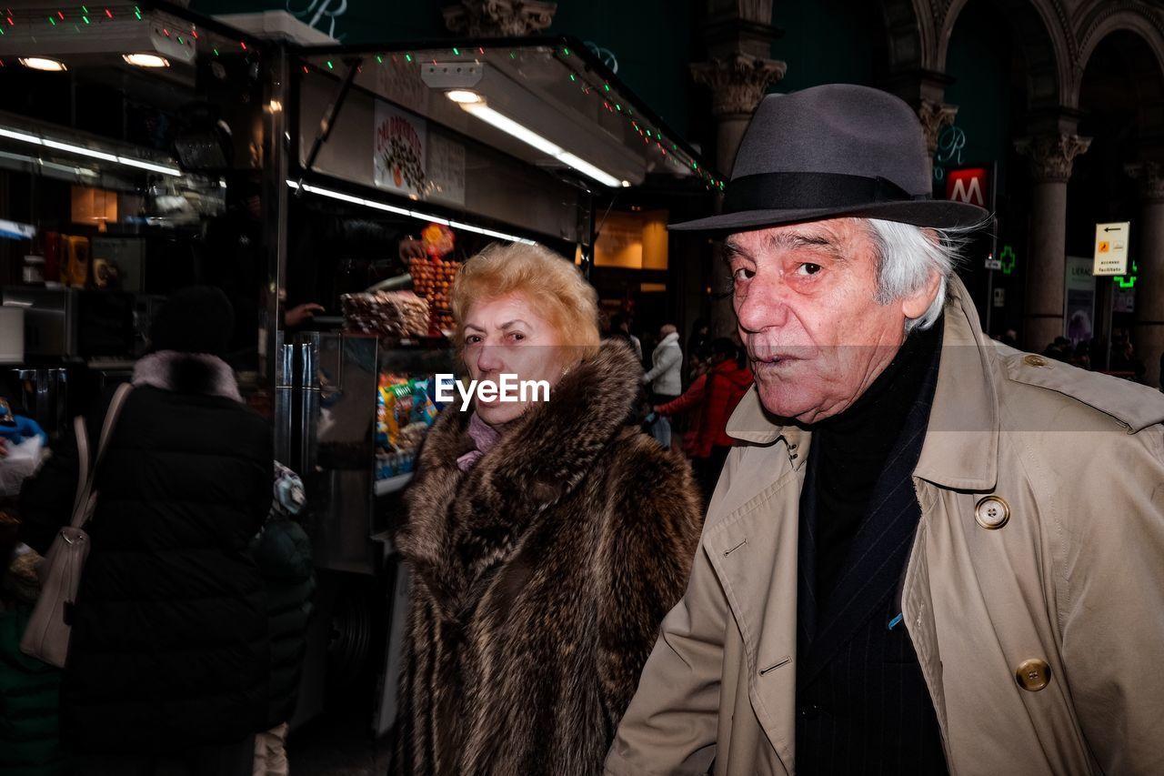 senior adult, senior men, night, real people, senior women, fur coat, warm clothing, lifestyles, illuminated, men, portrait, city, outdoors, adult, people