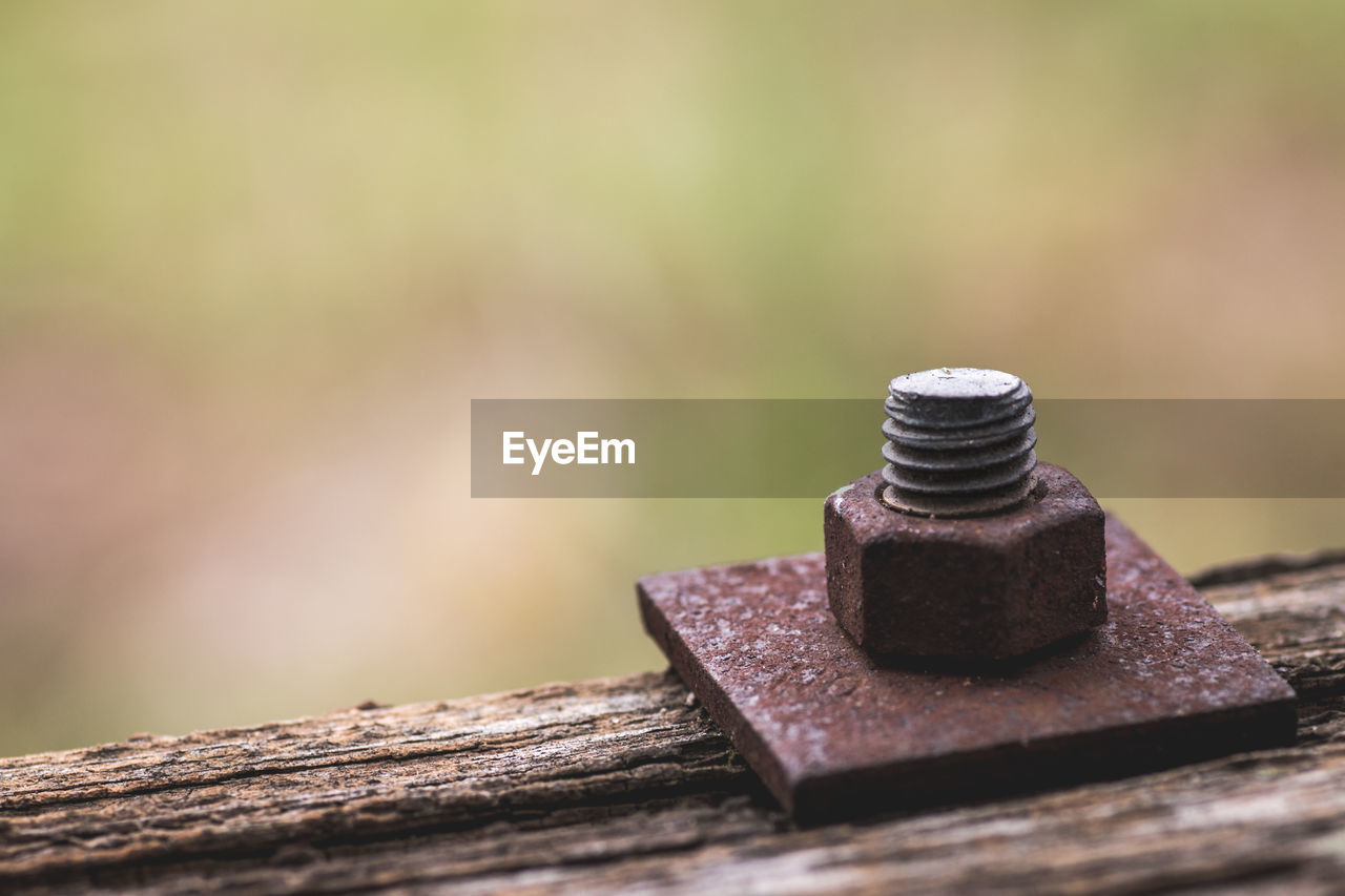 Close-Up Of Nut And Bolt On Wood