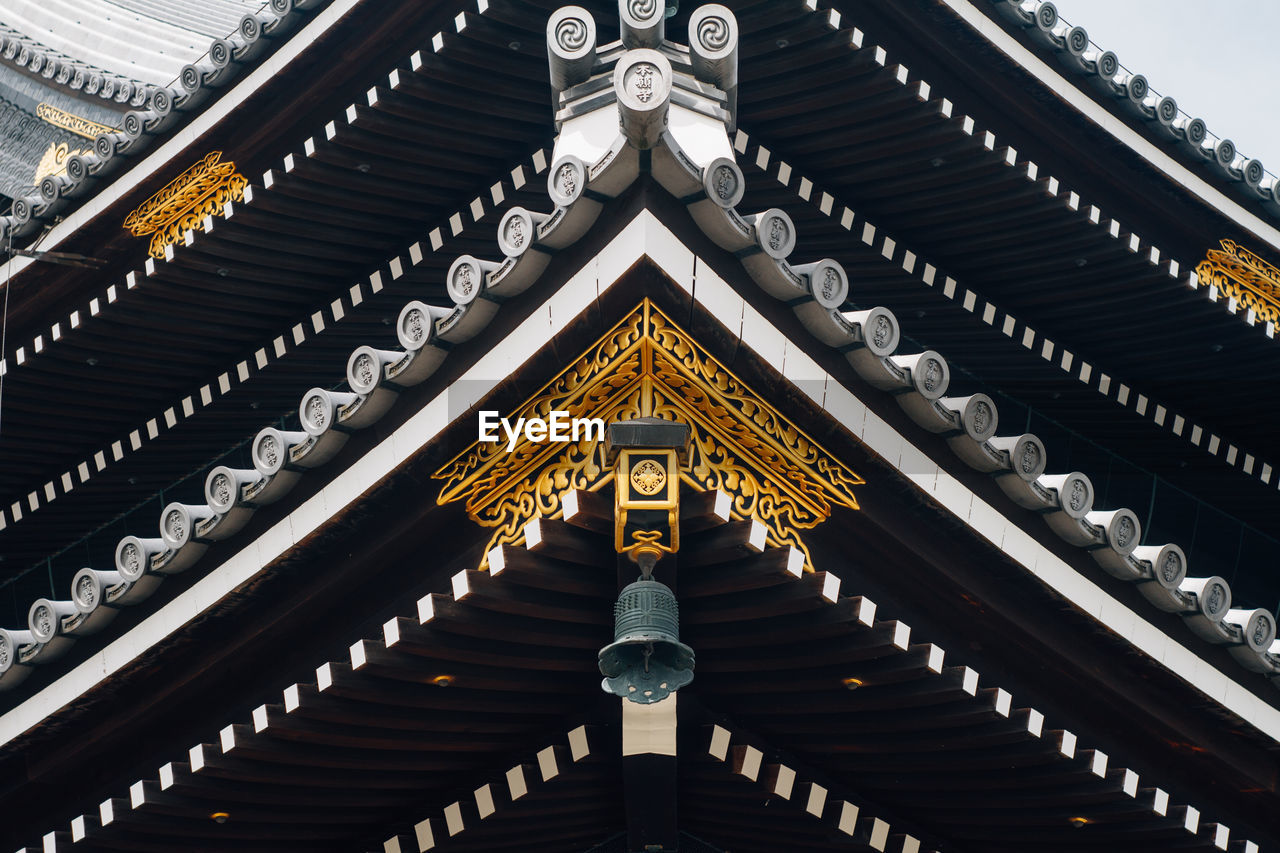 low angle view, architecture, built structure, spirituality, religion, place of worship, building exterior, no people, outdoors, gold colored, day, sky