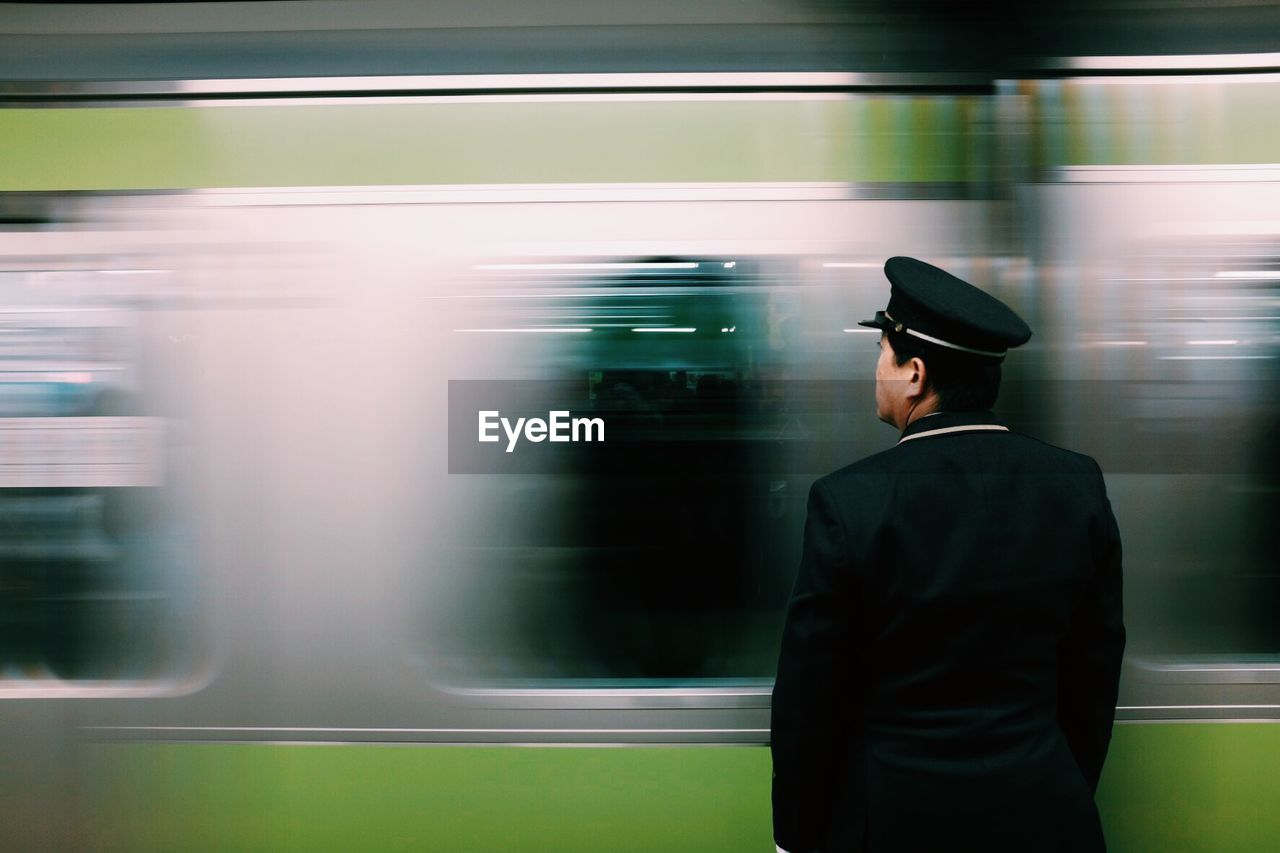 Security Guard Looking At Subway Train