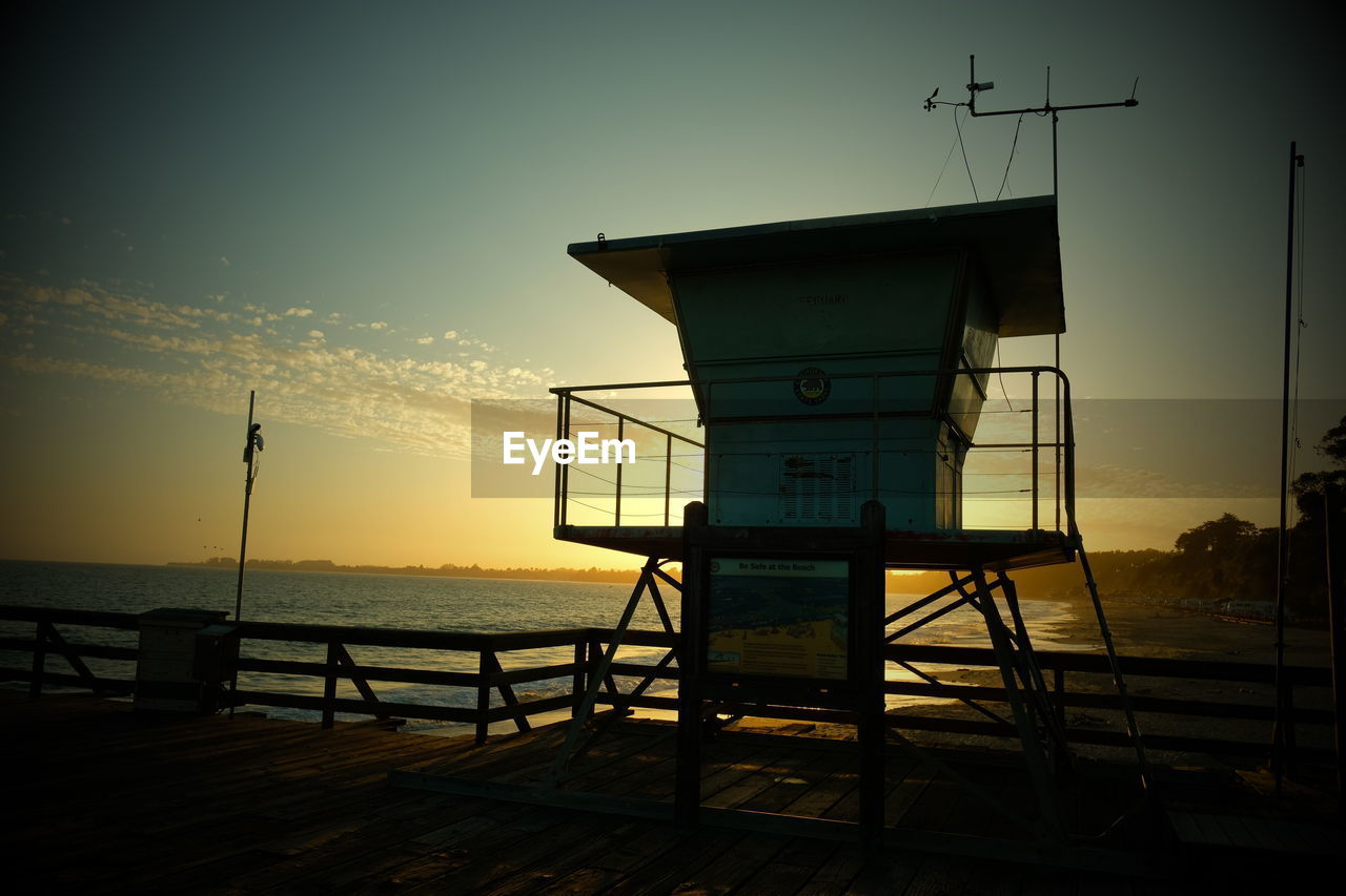 sky, sunset, water, sea, lifeguard hut, safety, man made structure, architecture, nature, hut, security, protection, built structure, cloud - sky, beach, building exterior, no people, horizon over water, tower, outdoors