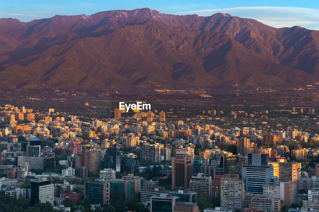 Panoramic view of providencia district with los andes mountain range in santiago de chile.