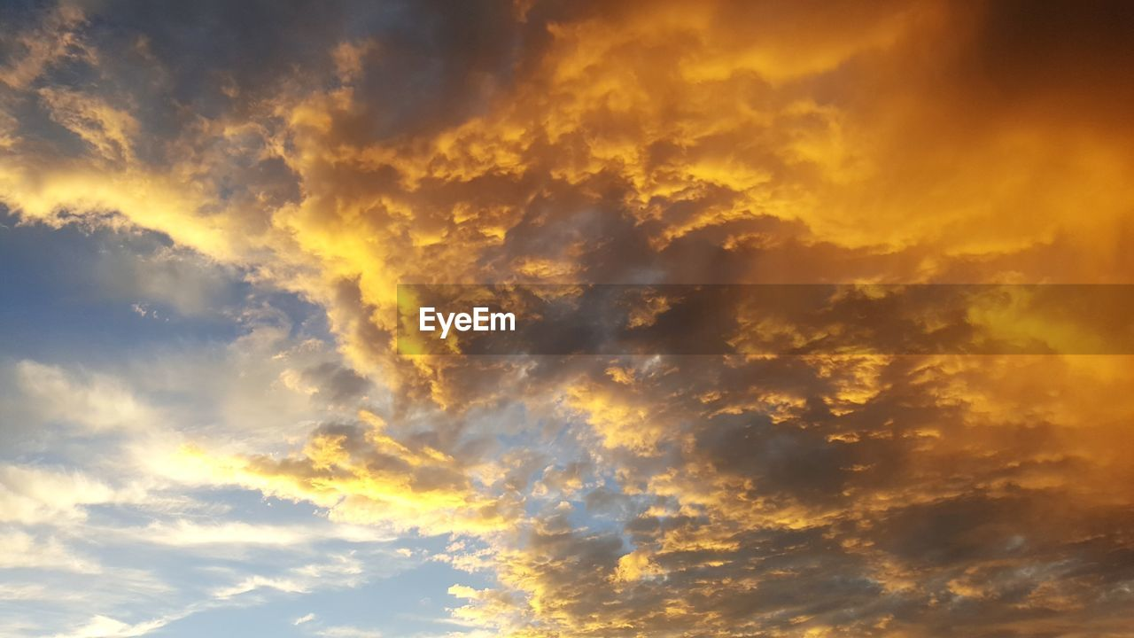 beauty in nature, nature, cloud - sky, sky, scenics, low angle view, dramatic sky, majestic, sunset, backgrounds, no people, tranquility, idyllic, weather, tranquil scene, sky only, outdoors, awe, yellow, day