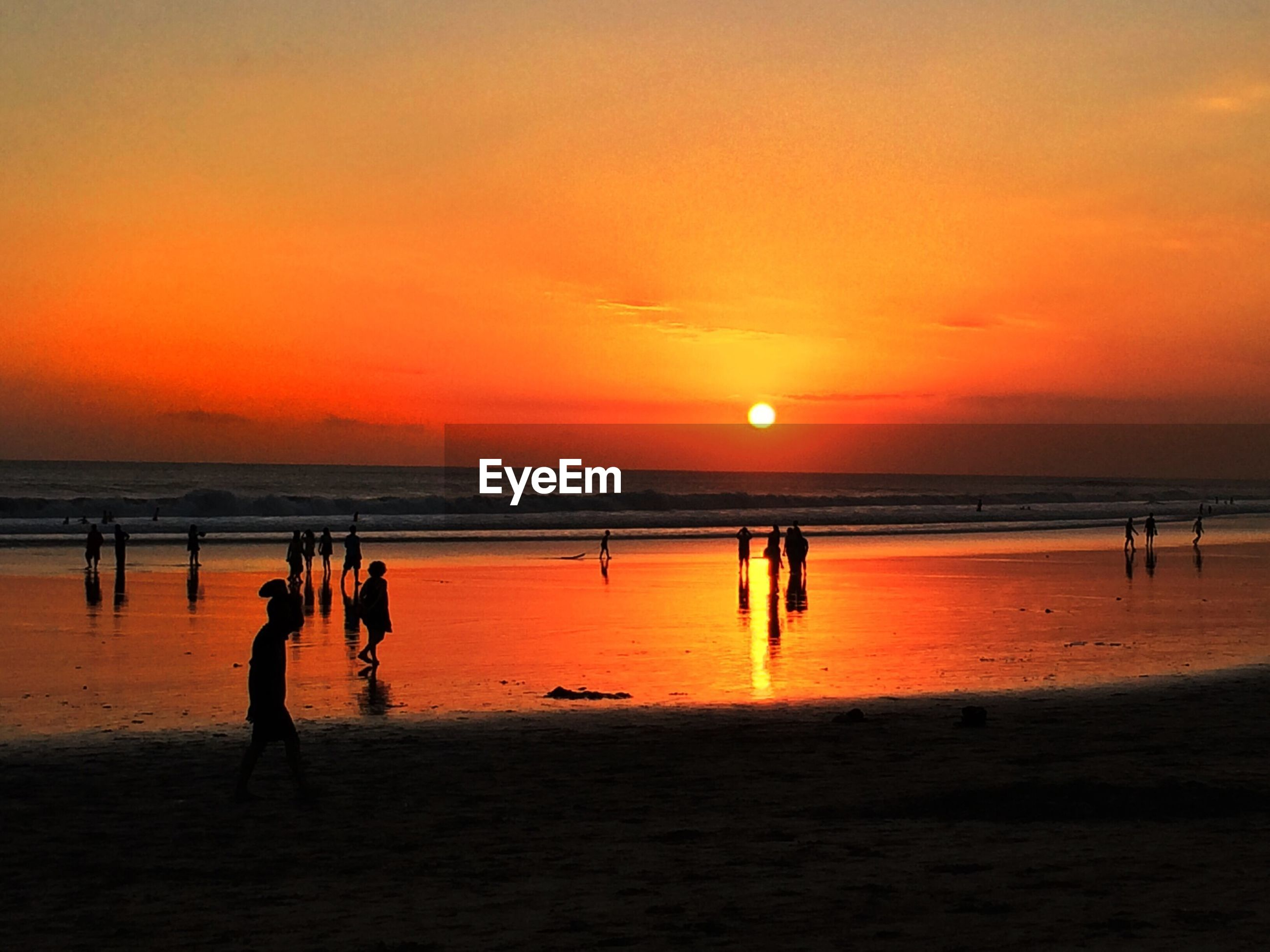 Scenic view of beach against orange sky