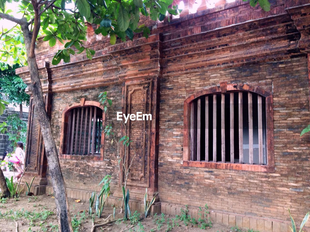 building exterior, door, architecture, built structure, old, history, entrance, window, gate, outdoors, day, tree, wood - material, no people, doorway, abandoned, old-fashioned, old ruin, ancient, travel destinations, nature