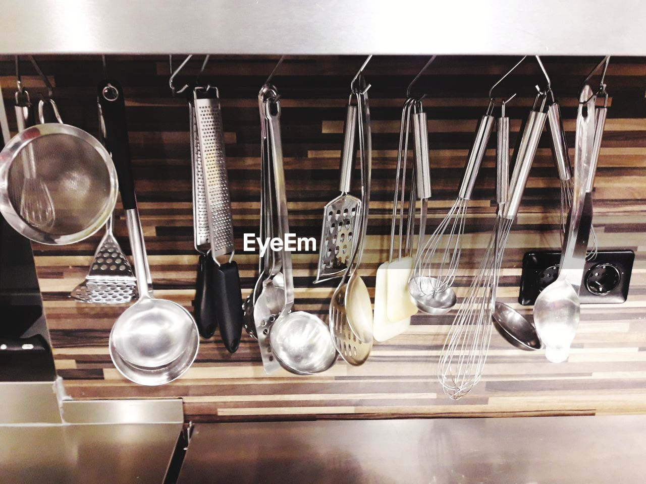 Close-up of kitchen utensils hanging on rack