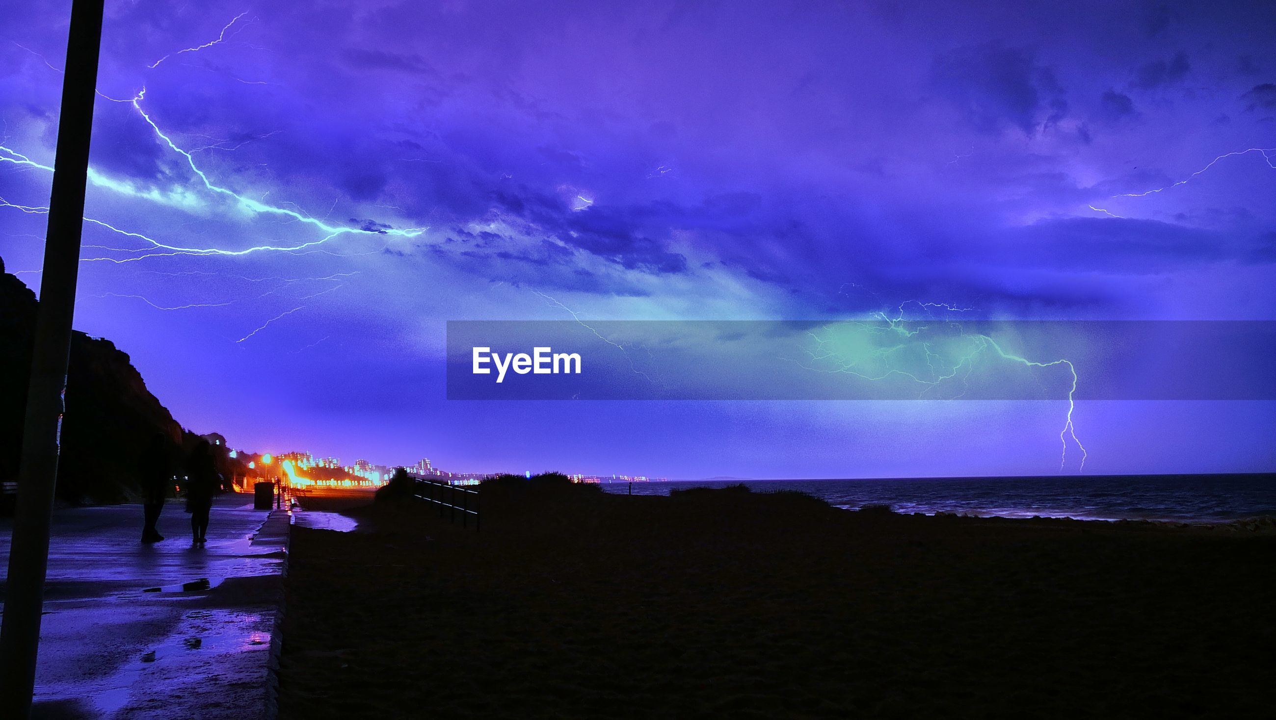 Thunderstorm over sea at night