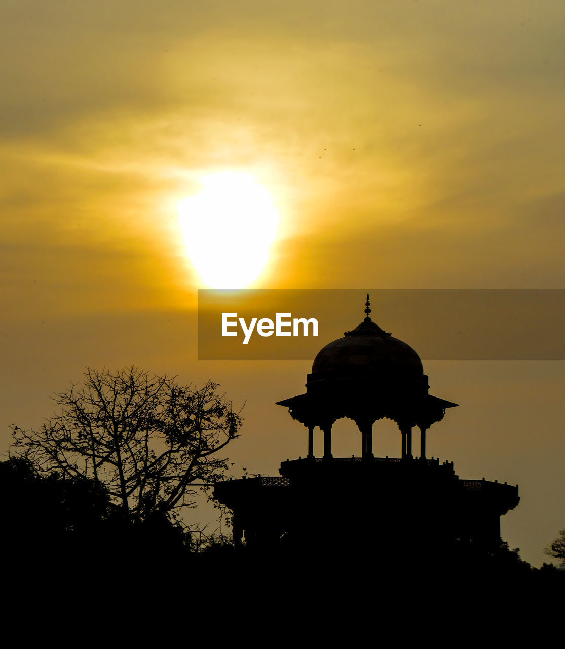 sunset, sun, silhouette, orange color, sky, outdoors, built structure, history, architecture, nature, travel destinations, ancient, sunlight, cloud - sky, no people, beauty in nature, low angle view, spirituality, tree, building exterior, scenics, dome, ancient civilization, day