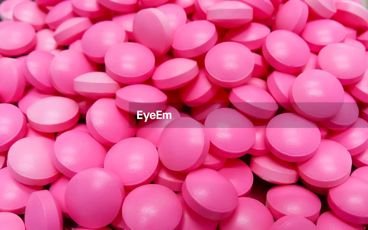 Full frame shot of pink medicines