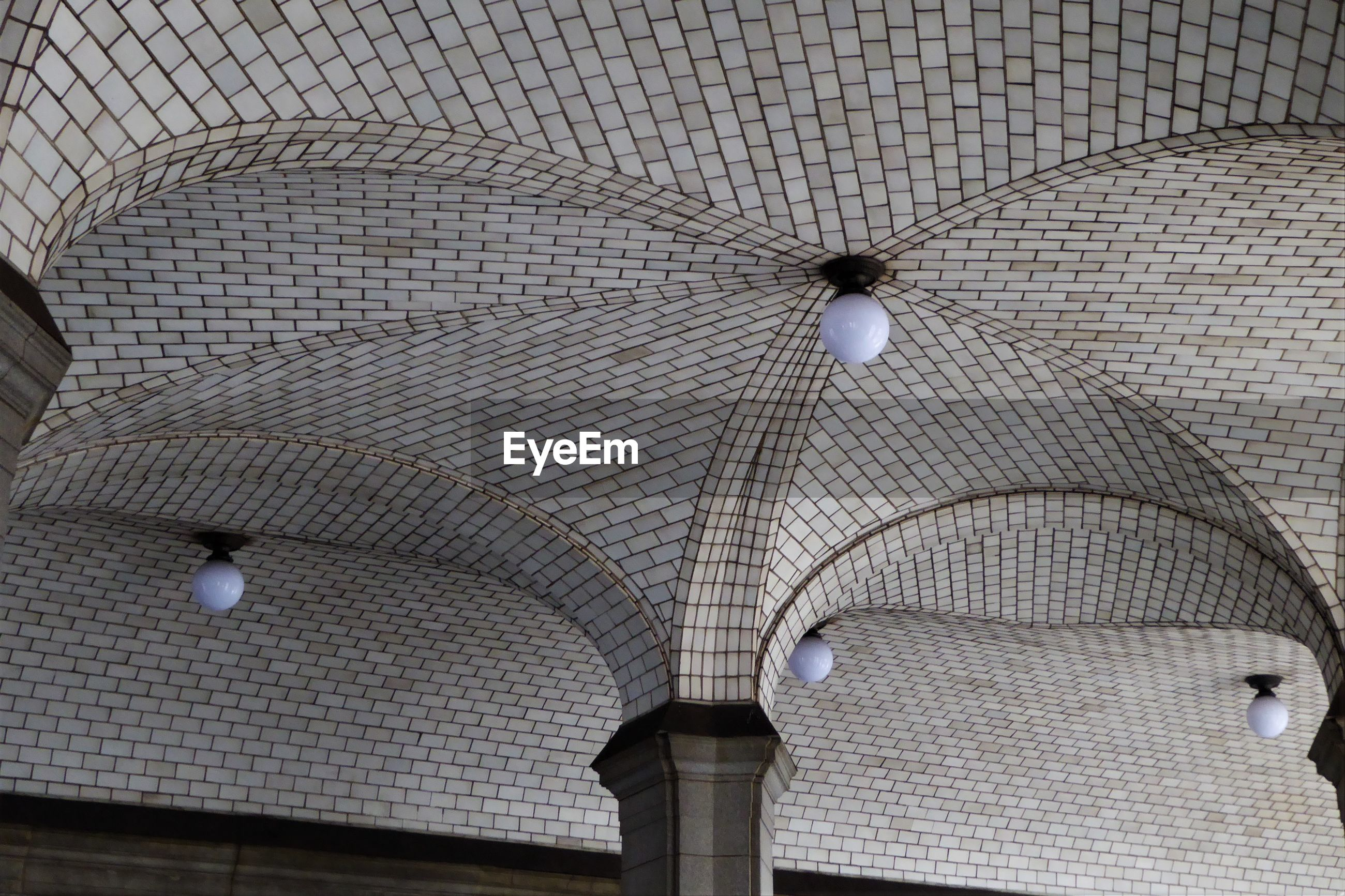 Low angle view of patterned ceiling in building