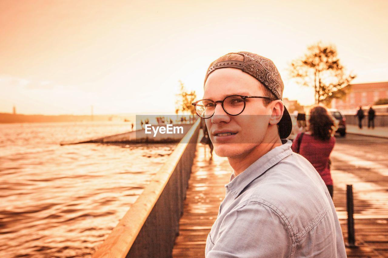 Portrait of man by lake