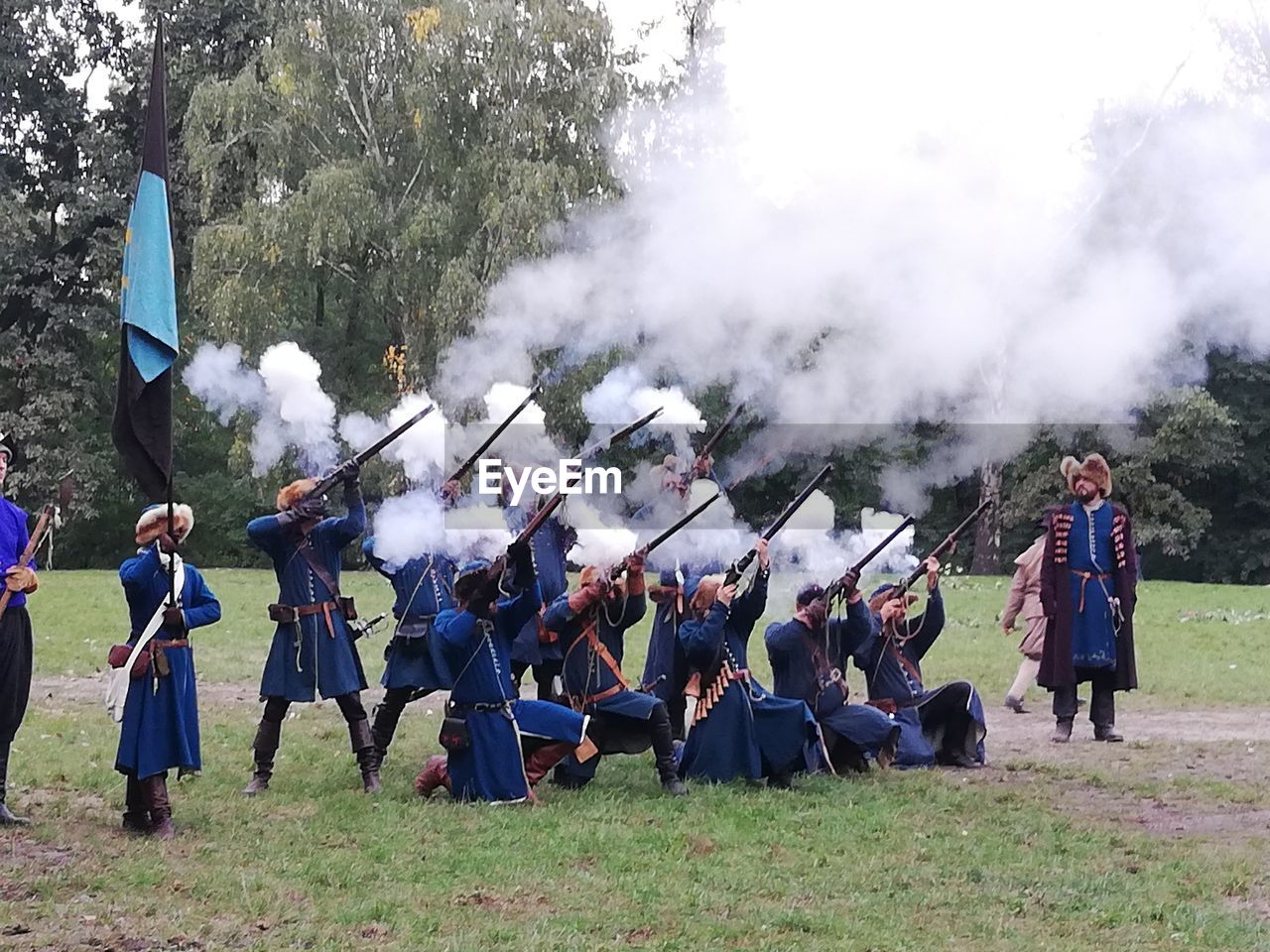 group of people, real people, large group of people, smoke - physical structure, crowd, day, men, celebration, musical instrument, plant, music, outdoors, full length, event, arts culture and entertainment, women, clothing, field