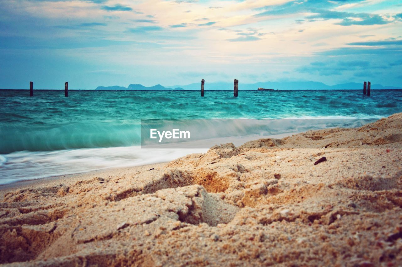 sea, water, beach, sky, nature, beauty in nature, sand, cloud - sky, scenics, no people, day, outdoors, horizon over water, wave