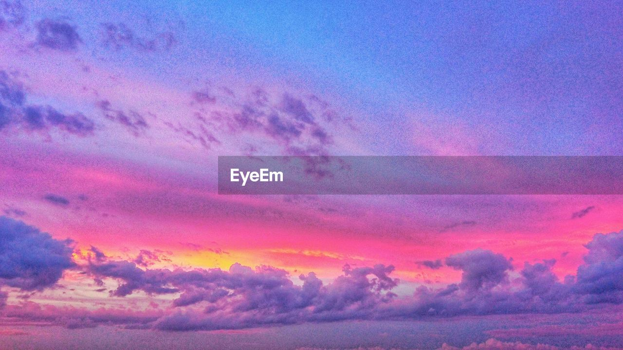 sky, cloud - sky, beauty in nature, sunset, scenics - nature, tranquility, tranquil scene, idyllic, orange color, nature, no people, dramatic sky, pink color, low angle view, outdoors, purple, dusk, backgrounds, majestic, non-urban scene, meteorology, romantic sky