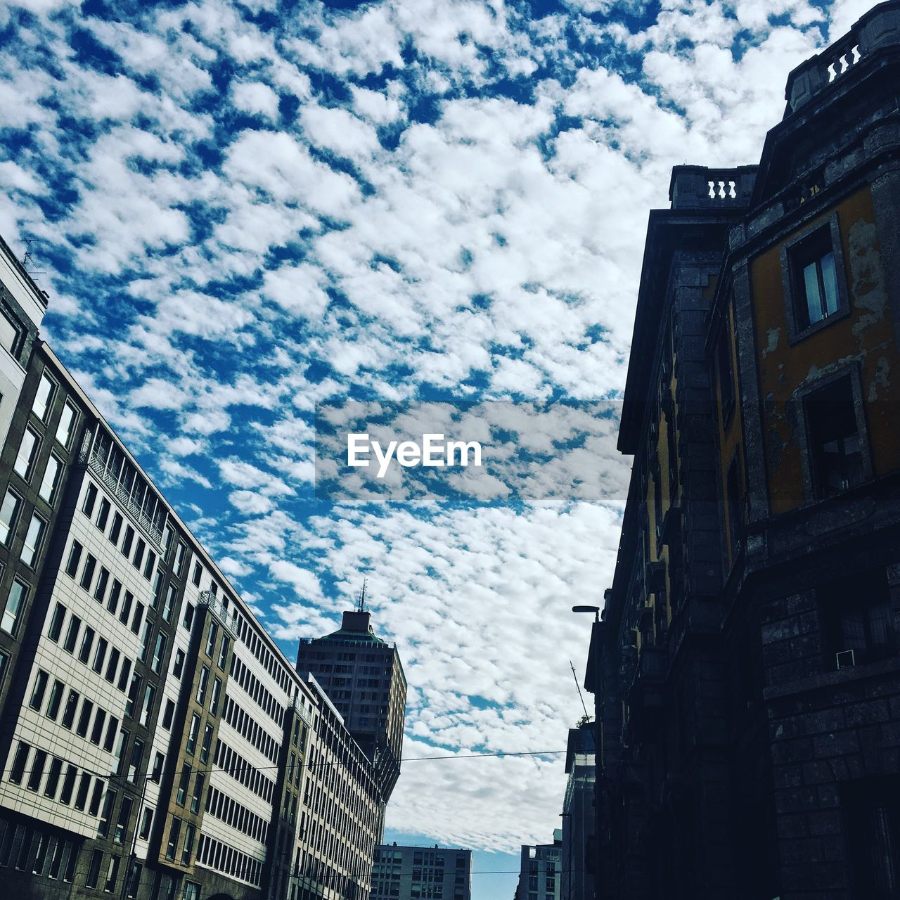 architecture, building exterior, built structure, low angle view, sky, cloud - sky, outdoors, day, no people, city