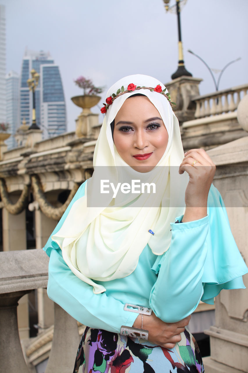 Portrait of beautiful woman in hijab standing outdoors