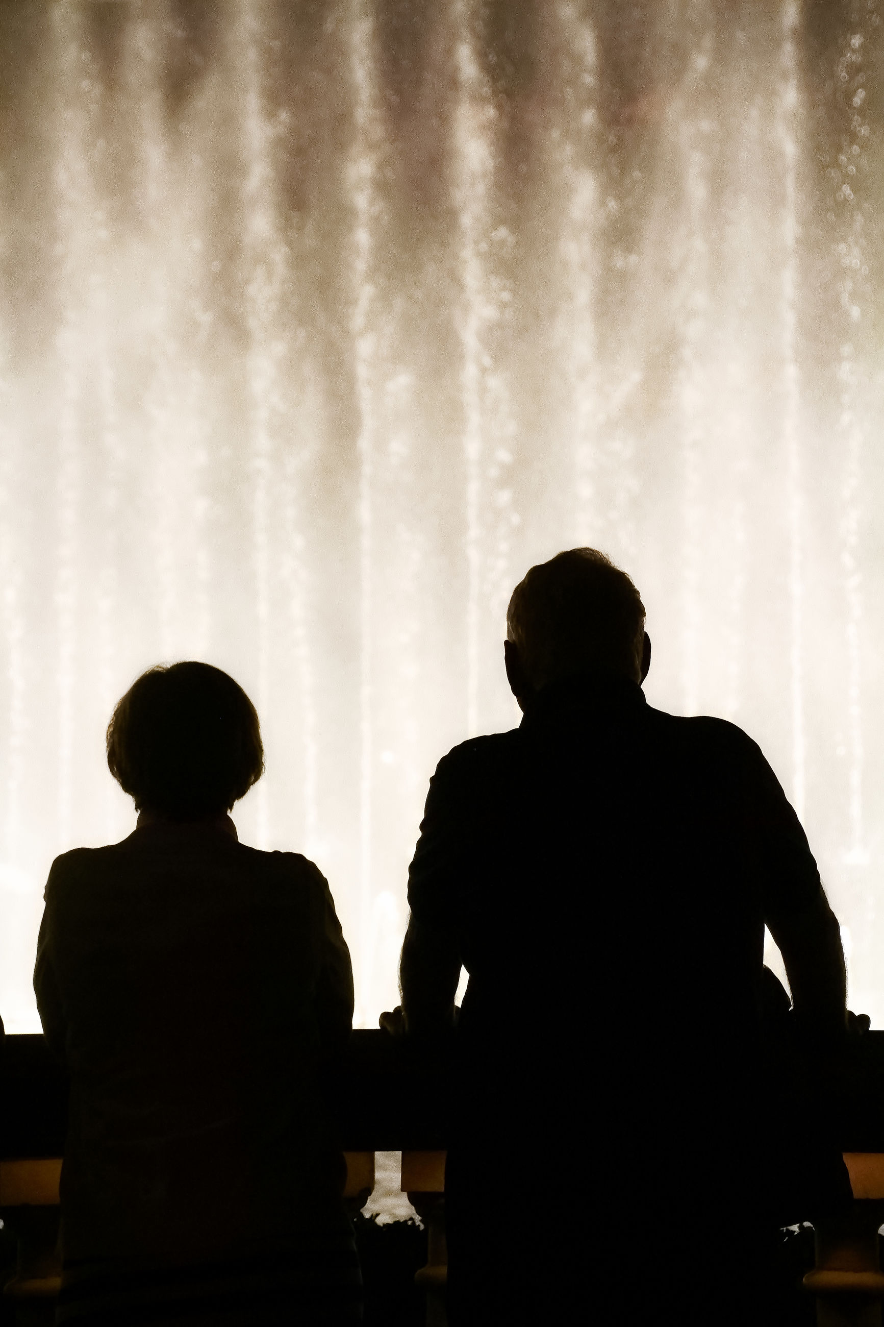 REAR VIEW OF SILHOUETTE MAN AND WOMAN STANDING IN ROOM